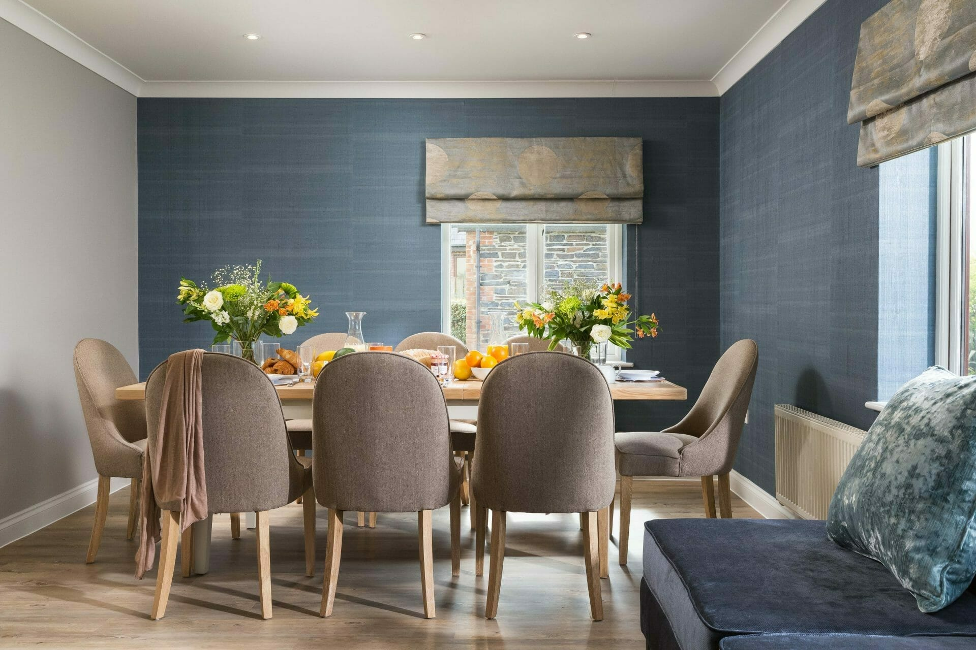 Navy blue wallpaper with little greene french grey painted wall in north cornwall holiday home